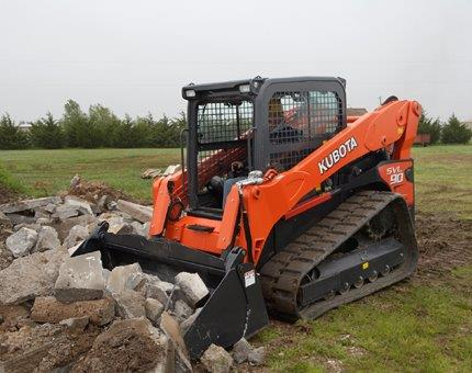 Earth Moving Kubota SVL90 Moving Rock